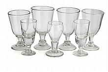 NEAR SET OF EIGHT DRINKING GLASSES 18TH/ 19TH CENTURY largest 18.5cm high