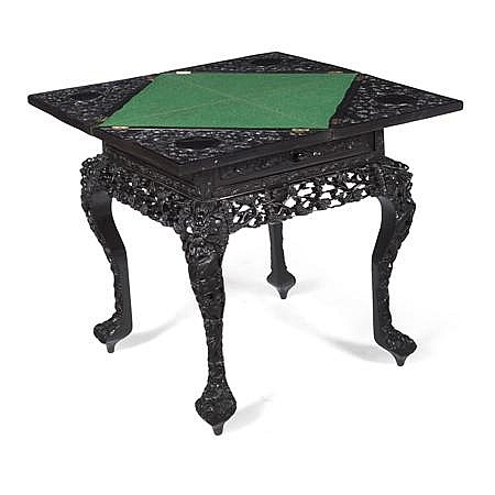 CHINESE CARVED HONGMU ENVELOPE GAMES TABLE LATE 19TH CENTURY 57cm wide, 76cm high, 57cm deep (closed)