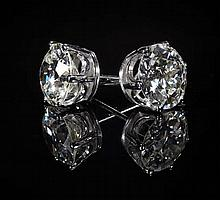 A pair of large diamond set ear studs Estimated diamond weights: 2.46cts and 2.43cts