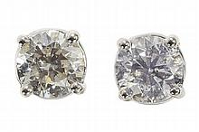 A pair of diamond set earstuds Estimated total diamond weight: 2.00cts