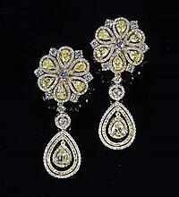 A pair of yellow and colourless diamond set ear pendants 4.5cm long