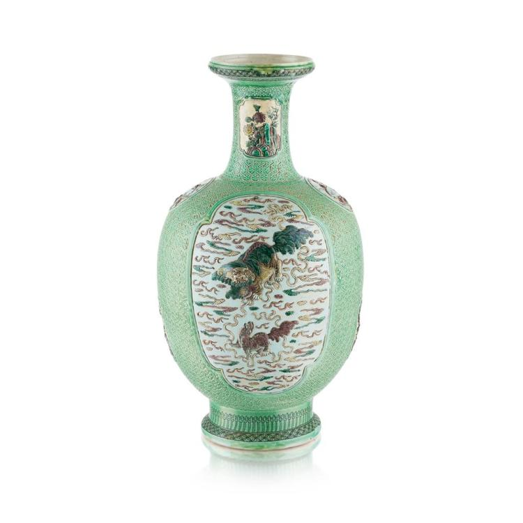 FAMILLE VERTE BISCUIT-GLAZED RELIEF-DECORATED BALUSTER VASE QING DYNASTY, 19TH CENTURY 49cm high (excluding pedestal)