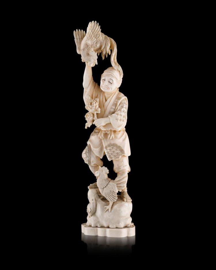 Y IVORY OKIMONO FIGURE OF A MAN WITH COCKERELS MEIJI PERIOD 32.3cm high