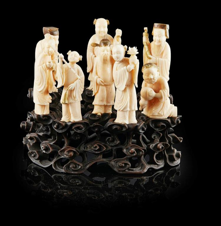 Y SET OF CARVED IVORY FIGURES OF THE EIGHT IMMORTALS LATE QING DYNASTY/REPUBLIC PERIOD tallest 9cm high
