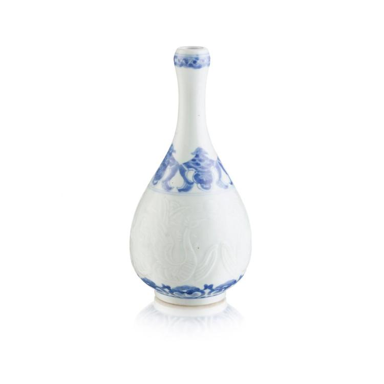 CARVED BLUE AND WHITE ''PHOENIX'' BOTTLE VASE GUANGXU MARK AND POSSIBLY OF THE PERIOD 24.5cm high
