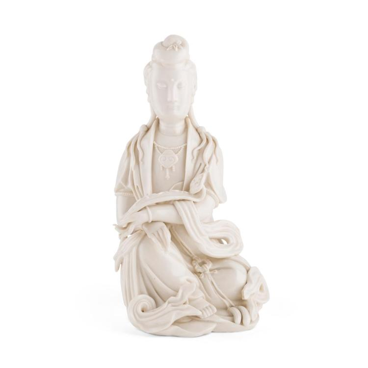 BLANC-DE-CHINE FIGURE OF SEATED GUANYIN QING DYNASTY, 18TH CENTURY 22.5cm high