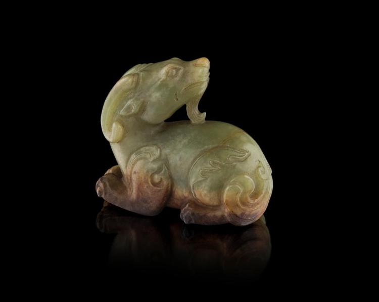 GREEN AND BROWN JADE CARVING OF A RAM QING DYNASTY, 19TH CENTURY 5.8cm long
