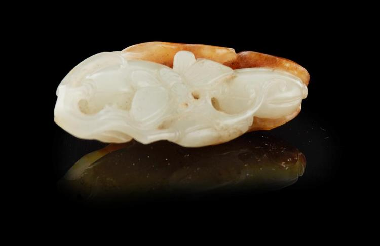 PALE CELADON AND RUSSET JADE PENDANT QING DYNASTY, 19TH CENTURY 4.8cm long