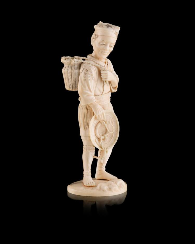 <sup>Y</sup> CARVED IVORY OKIMONO OF A FISHERMAN SIGNED GYOKURYU, MEIJI PERIOD 20.5cm high
