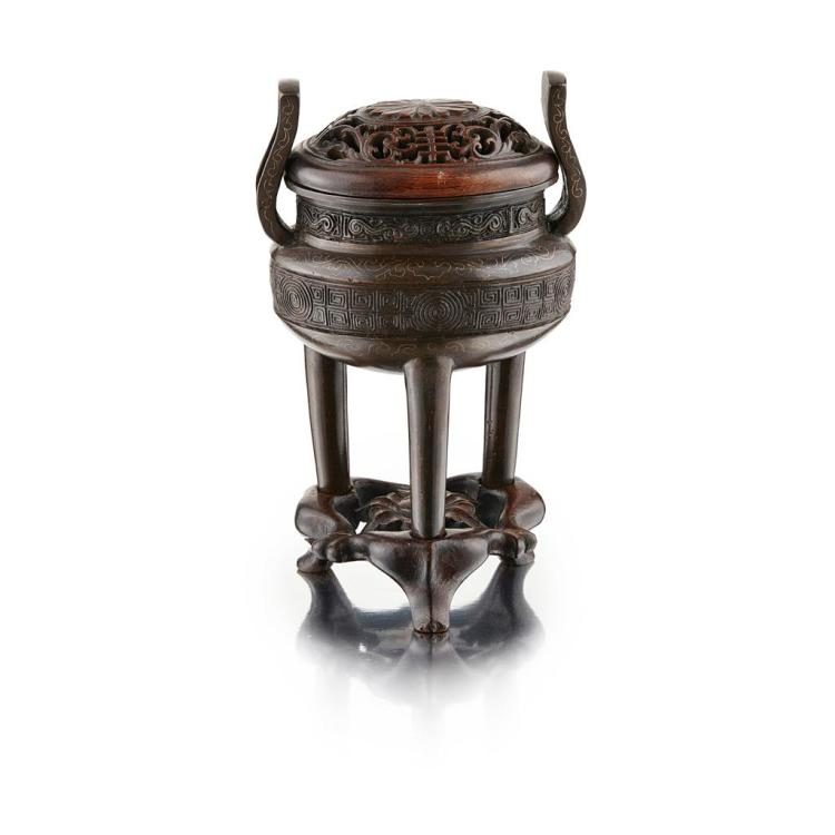 SILVER-INLAID BRONZE TRIPOD CENSER, DING SIGNED SHI SOU, 18TH CENTURY 14.5cm high (excluding stand)