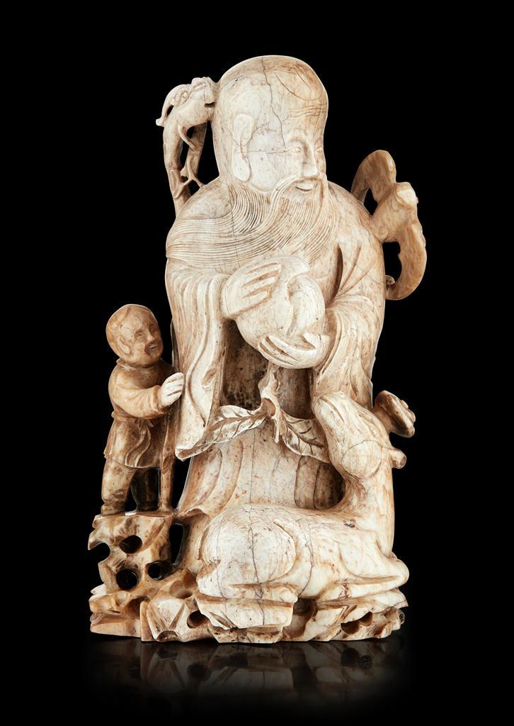 'CHICKEN BONE' JADE FIGURE OF SHOULAO QING DYNASTY, 18TH CENTURY 16cm high