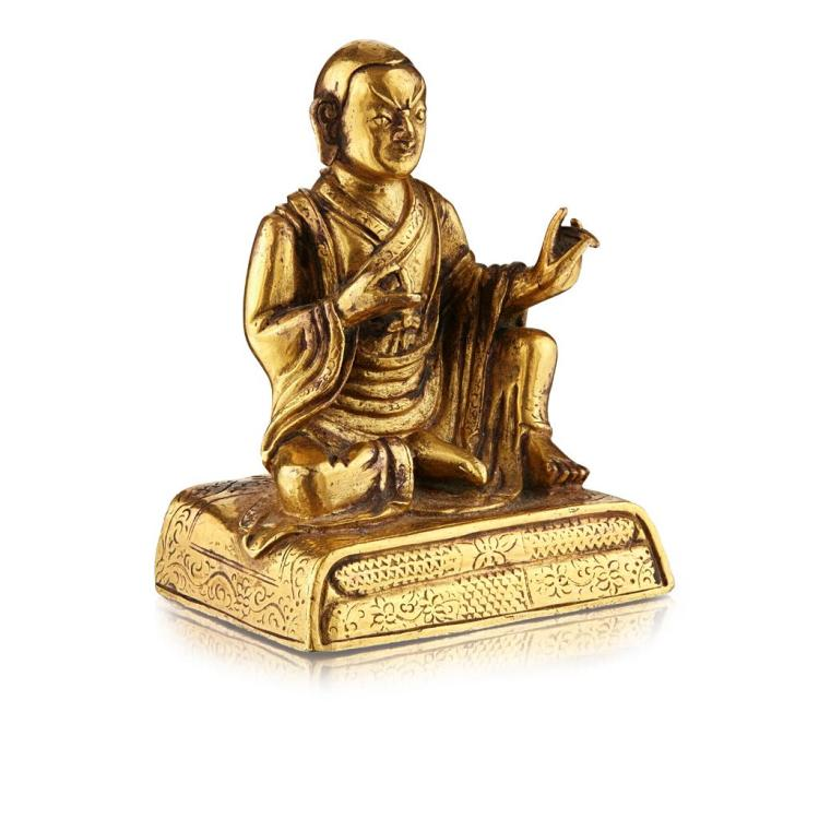 SMALL GILT BRONZE FIGURE OF A LUOHAN QING DYNASTY, 18TH CENTURY 6.8cm high