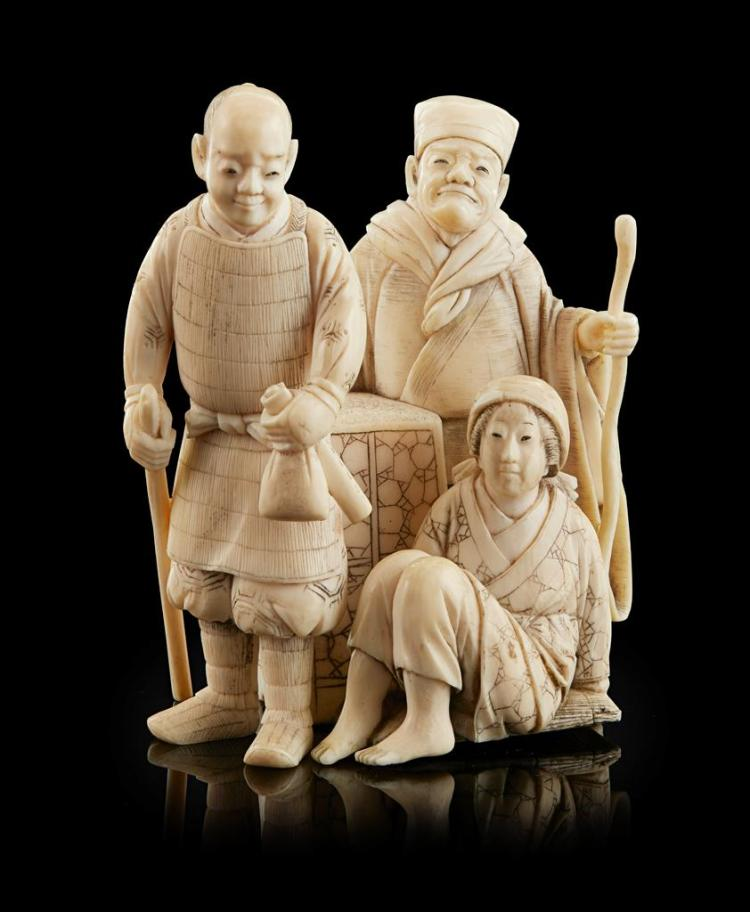 <sup>Y</sup> CARVED IVORY OKIMONO OF A FIGURAL GROUP SIGNED MORI HISASHI, MEIJI PERIOD 8cm high