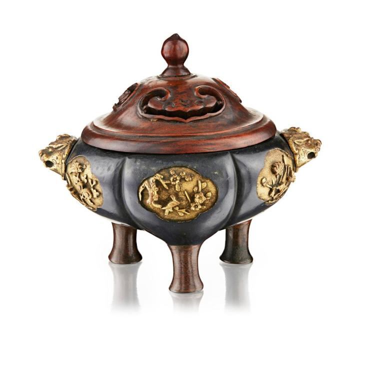 PARCEL-GILT BRONZE TRIPOD CENSER 11cm wide