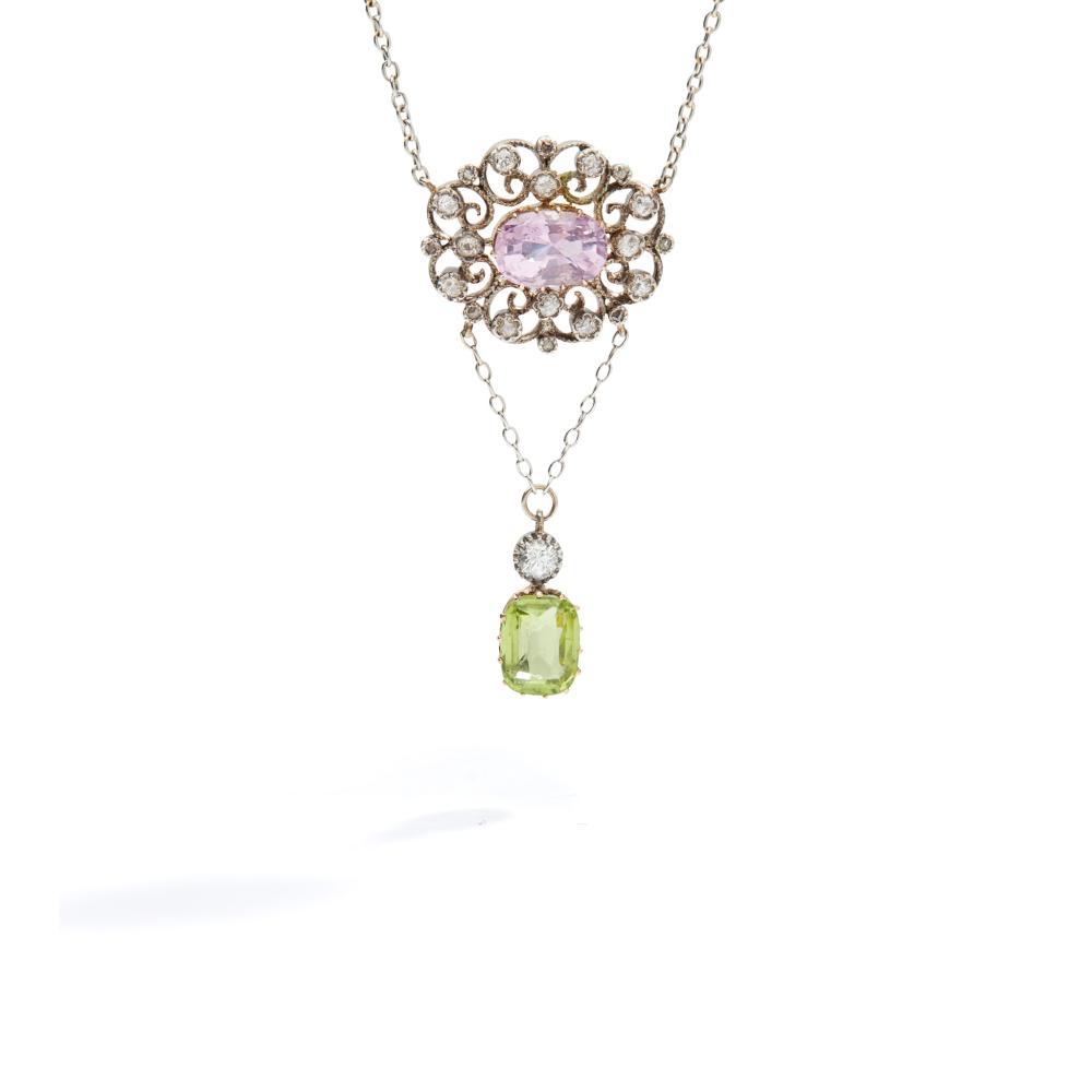 An early 20th century pink sapphire, diamond and peridot pendant, circa 1910