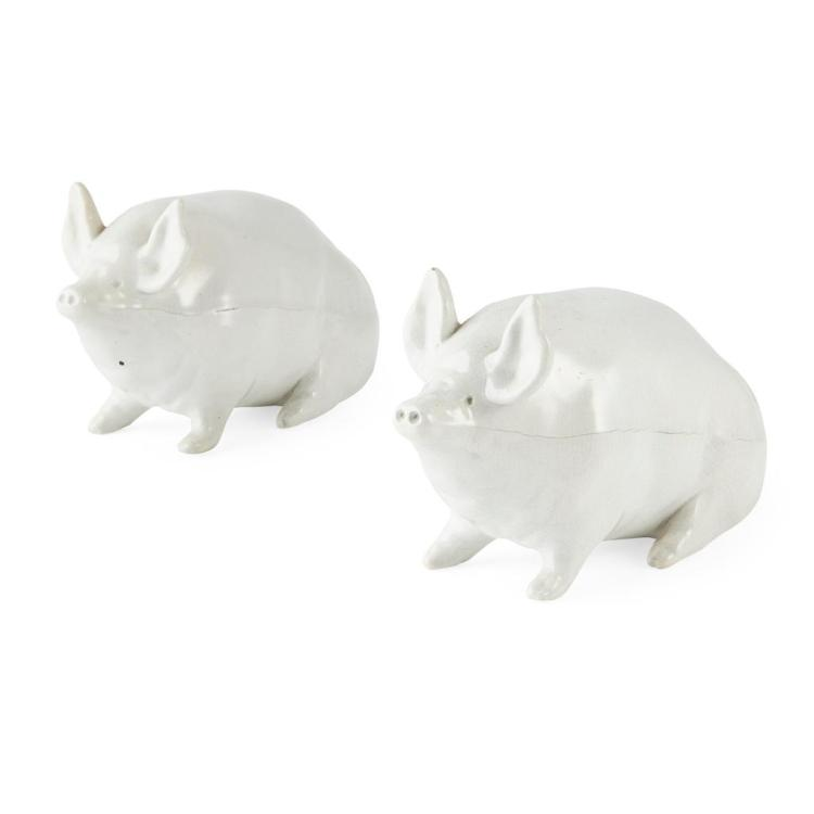 WEMYSS WARE A PAIR OF SMALL WHITE-GLAZED PIGS, CIRCA 1900 16cm long
