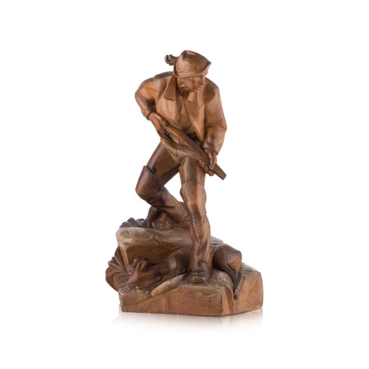 ATTRIBUTED TO OTTO MORODER CARVED FIGURE OF A HUNTSMAN 38.5cm high