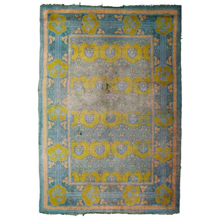 ATTRIBUTED TO C.F.A. VOYSEY FOR LIBERTY & CO., LONDON ''THE GLENMUIR'' ARTS & CRAFTS DONEGAL WOOL CARPET, CIRCA 1903 440cm x 304cm