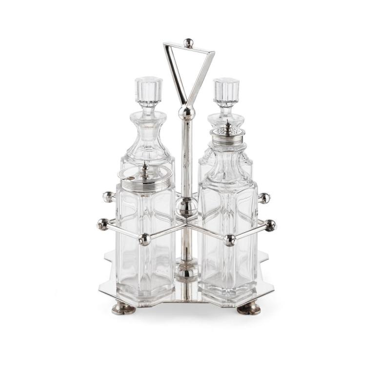 MANNER OF CHRISTOPHER DRESSER, HUKIN & HEATH, LONDON ELECTROPLATED CRUET SET, CIRCA 1880 22.5cm high
