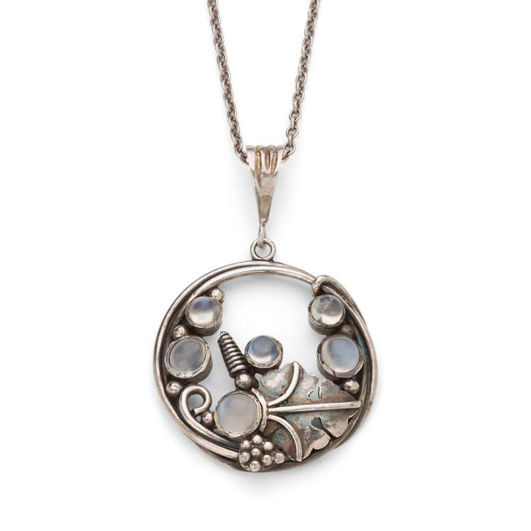 DORRIE NOSSITER (1893-1977) ARTS & CRAFTS WHITE METAL AND MOONSTONE SET PENDANT, CIRCA 1910 2.7cm diameter