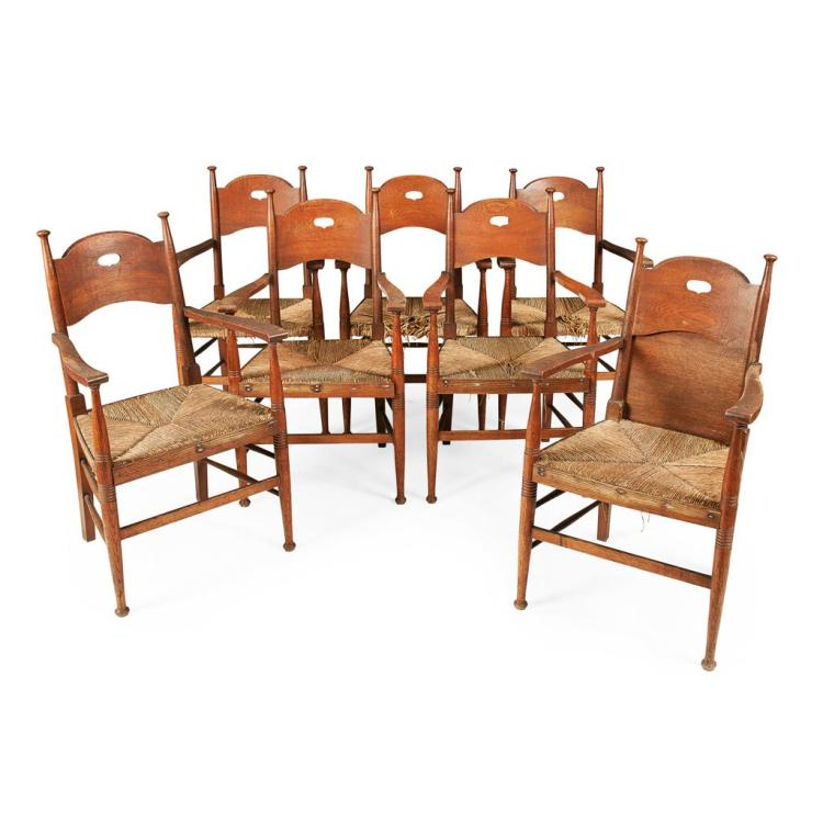 WILLIAM BIRCH, HIGH WYCOMBE SET OF SEVEN OAK ARMCHAIRS, CIRCA 1900 57cm wide, 97cm high, 45cm deep