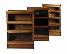 GROUP OF THREE GLOBE-WERNICKE BOOKCASES the tallest 87cm wide, 148cm high, 32cm deep