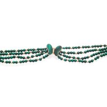 A multi-strand malachite necklace Length: 39cm