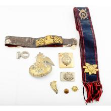 QUEEN''S ROYAL BODYGUARD - A shoulder belt with gilt and enamelled badge and a silver oval badge