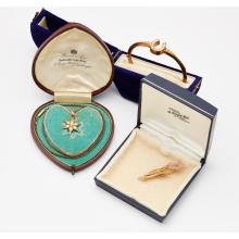 A gem set floral brooch Length of brooch: 48mm