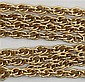 A yellow metal muff chain 39g, 83.5cm long