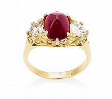 A cabochon ruby and diamond set three-stone ring Ring size: N