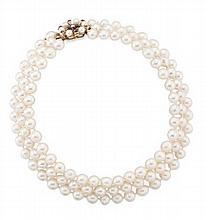 A triple strand cultured pearl necklace Length: 34cm (shortest strand)