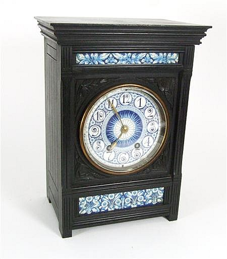 LEWIS F. DAY (1845-1910) FOR HOWELL & JAMES ELKINGTON & CO. EBONISED MANTED CLOCK, CIRCA 1880 39cm high
