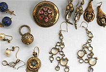 A collection of gold ear pendants and brooches