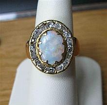 A late Victorian opal and diamond cluster ring Ring size: M, 10.3g
