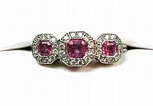 A pink sapphire and diamond set ring Ring size: K/L