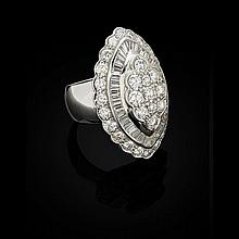 A diamond set cluster ring Ring size: N/O