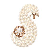 SEAMAN SCHEPPS - A pearl and diamond set bracelet Length: 19cm