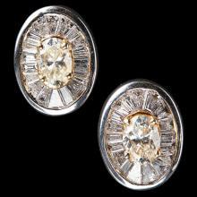 A pair of diamond set studs Length: 18mm