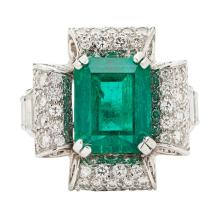 An emerald and diamond set cocktail ring Ring size: M, estimated emerald weight: 4.70cts