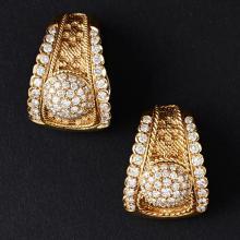 A pair of diamond set ear clips Length: 23mm