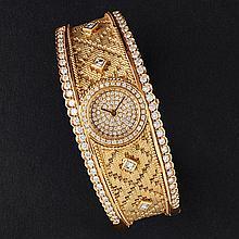 A diamond set bangle watch Dial diameter: 15mm, internal width: 60mm