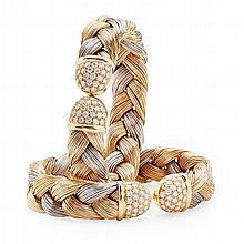 A pair of modern diamond set bangles Internal width: 55mm