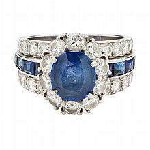 A sapphire and diamond set cluster ring Ring size: M, estimated gem weights: sapphire 2.22cts, principal diamonds 0.80cts