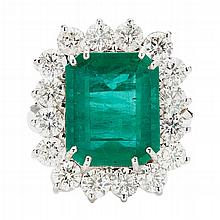A large emerald and diamond set cocktail ring Ring size: R, estimated total gem weights: emerald 8.77cts, diamonds 3.20cts