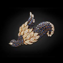 JAHAN GENEVA - A diamond and sapphire set brooch Height: 95mm, width: 63mm