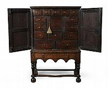 SMALL QUEEN ANNE OAK CHEST ON STAND EARLY 18TH CENTURY 77cm wide, 119cm high, 41cm deep
