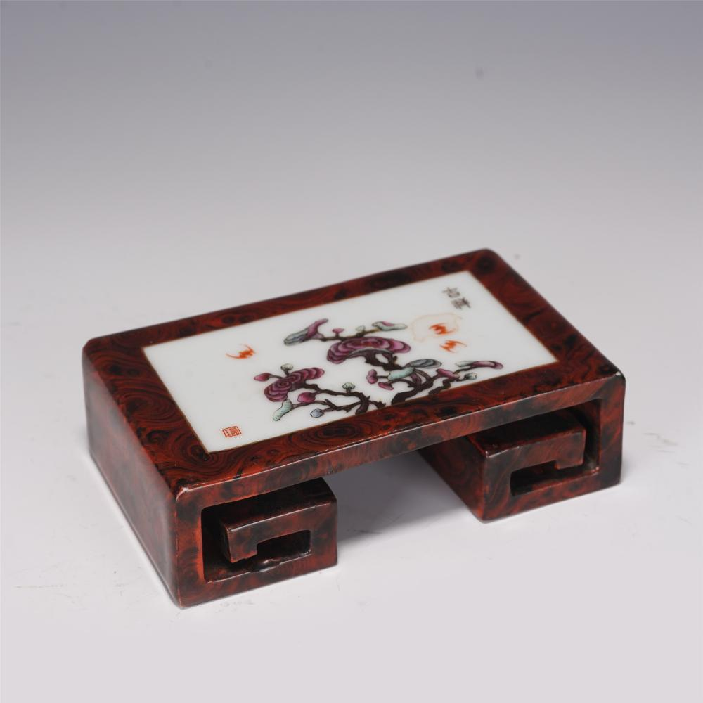 A CHINESE STONE-GRAIN GLAZE FAMILLE ROSE INK-STICK REST