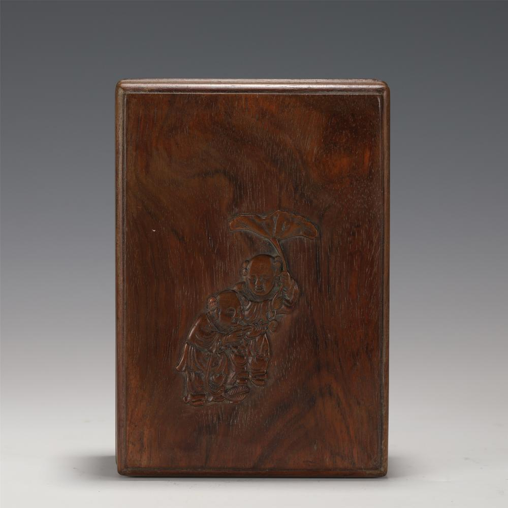 A CHINESE CARVED FIGURAL HARDWOOD BOX AND COVER