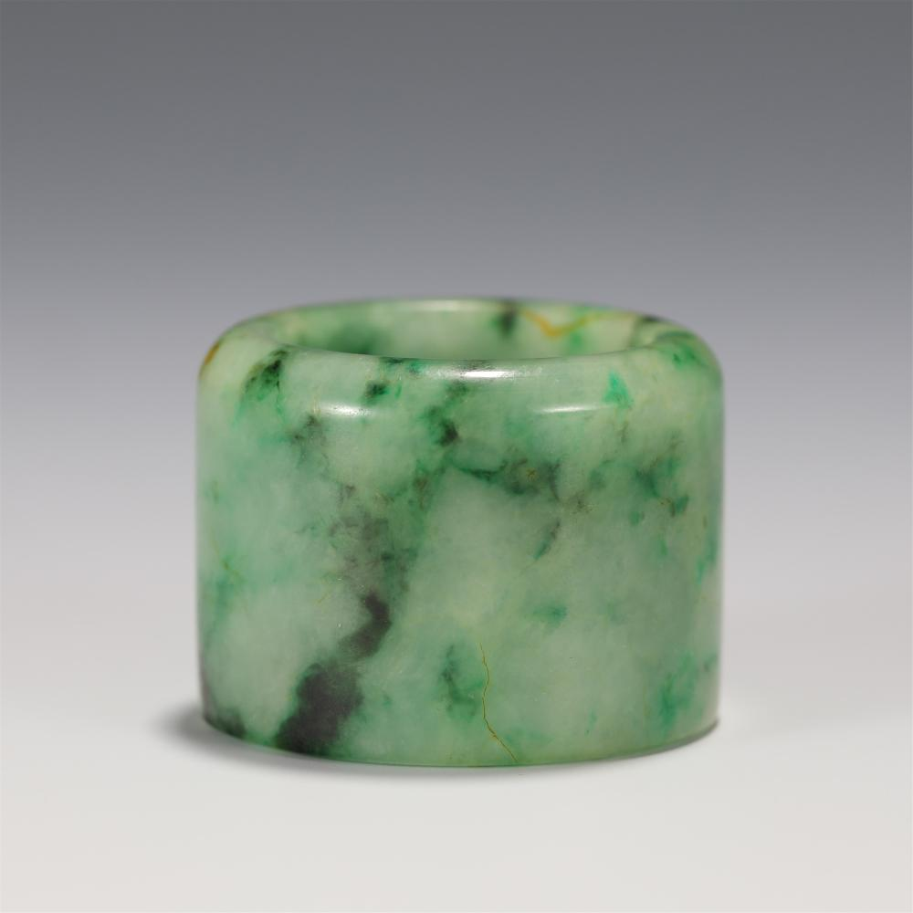 A CHINESE CARVED JADEITE THUMB RING
